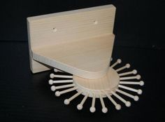 In need of a revolving tie rack? Check out this handmade pine tie-rack that holds 24 ties and rotates for your convenience and organizational needs.