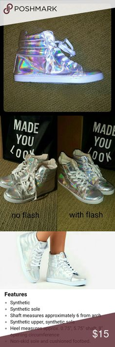 Holographic Hightop Sneakers Holographic hightop lace up shoes. 4th photo (collage) shows soles and slight scuffs. Owned for 3 years and worn 3 times! I wear a 7.5 and these are slightly roomy at the toe. Qupid Shoes Sneakers