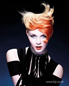 Hair was undercut with longer lengths on top. The front was coloured orange and blow-dried for a soft finish.