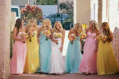 Pink blue and yellow mixed colour bridesmaid dresses...  Cute but I don't think I'd go for a mix of colours like this