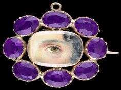 Georgian lover's eye brooch surrounded by amethysts.