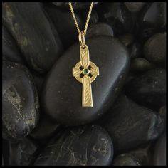 Dainty Celtic cross shown with a Tsavorite Garnet.