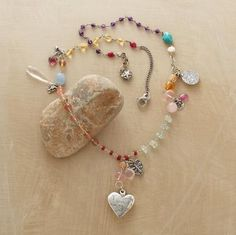 Turquoise, sunstone, moonstone, quartz, tourmaline, citrine and amethyst gemstones along with whitehearts and sterling silver charms.