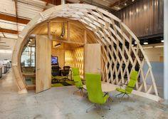 Geometric wood sculpture, concrete floors, pops of color