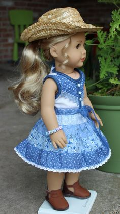 This outfit has been made to fit 18 dolls like American Girl. This outfit is made of a tiered skirt in country blue fabrics. The skirt has an elastic waist. The sleeveless shirt closes in the back with no-snag Velcro. It has denim trim on the front, neckline and armholes. The lace belt is removable. American Girl Tenney Grant is modeling this outfit for us. I am including the elastic bead bracelet that says Tenney. Doll, hat and shoes are not included in this sale. I found the straw hat at…