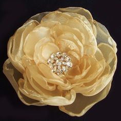 Love this from Pink Apple Cache.  Flower Hair-Clip Headband Brooch - Honey-Spice with Jewels - LARGE
