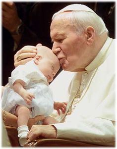 Pope John Paul II, the next saint to be canonized.  This man just radiated love, look at this picture and believe.