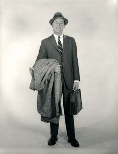 standing smiling man wearing hat business suit overcoat on arm briefcase looking at camera 1950s Mens Suits, Suit Overcoat, Barefoot In The Park, Smiling Man, Briefcase For Men, Male Figure, Classic Man, Strike A Pose, Photo Library