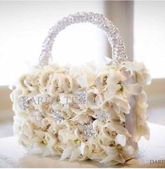 Pocketbook of posies! She is unbelievable! Florist Extraordinaire- Karen Tran - The Enchanted Home