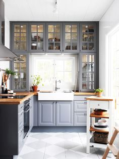 Traditional Gray Kitchen With Wood Countertops