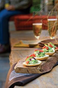 Mini pita rounds create a sturdy base for Guacamole-Goat Cheese Toasts. Feel free to use French baguette slices instead. Top with chopped tomatillo and tomato for a touch of crisp acidity.Recipe: Guacamole-Goat Cheese Toasts