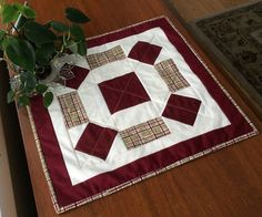 """Add interest to a table with this burgundy and plaid handmade square quilted table topper. Great for the center of a dining table, night stand, or coffee table. Add a lamp, plant, condiments, appetizers...works for any occasion.  Measures 17 1/2"""" x 17 1/2"""" #tabletopper #quilt"""
