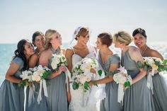 Dusty blue bridesmaids dresses for a classic wedding along the water. | Miranda Lawson Photography