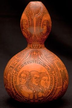 Gourd decorated with figures from the French Revolution, stained with blood from Louis XVI (confirmed by genetic testing against sample from mummified head of Henry IV). Fascinating.