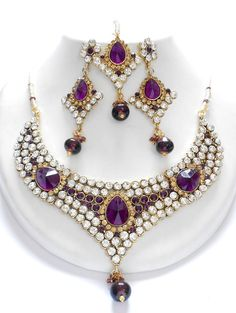 Unique and stylish Exclusive Indian  Fashion Jewelry sets, this fashion  jewellery sets contains a necklace,  matching pair of earrings, and mangtikka.  This set is beautifully designed with the  very high quality CZ and AD stones which  makes it more gorgeous and attractives.     visit www.impexfashions.com for more collections