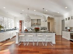 Beautiful kitchen with Brazilian cherry floors, white shaker cabinets, and island New Canaan, CT Brazilian Cherry Hardwood Flooring, Brazilian Cherry Floors, Cherry Wood Floors, Best Kitchen Cabinet Paint, Custom Kitchen Cabinets, Painting Kitchen Cabinets, Shaker Cabinets, Corner Cabinets, Custom Kitchens