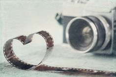 Picture of Heart shaped from film negative and old vintage camera - concept for photography stock photo, images and stock photography.