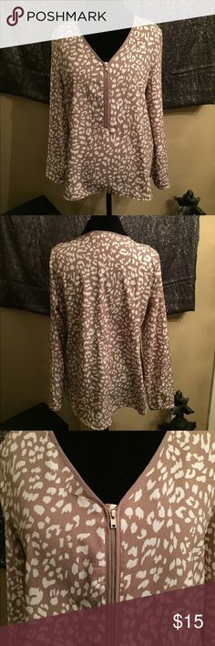 Apt 9 Top Silky and Chic animal print top. V neckline with zipper, long sleeves with 1 button cuffs, high - low shirttail hem. Color is light taupe and ivory. Fabric is 100% polyester. Like New Condition! Apt. 9 Tops Blouses