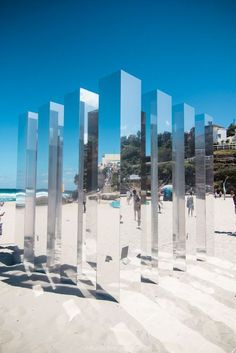Outdoor exhibit, transformation, discovery, change in idea of space, walk in and out of GS and affect company, different materials, reflective, mirror outside - wood inside, color / fabric in the core; Kaleidoscope cube so Bondi Beach, Aust., by Alex Ritchie