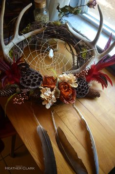Large Fall Themed Real Antler Dream Catcher Wreath with Feathers, Flowers and Lotus Pods #wreath #fallwreath #antlerwreath #antlers #rustic #fall #fallcolors #dreamcatcher #lotusflower #floralarrangement #grapevinewreath by TheSleepingSirens on Etsy https://www.etsy.com/listing/477419363/large-fall-themed-real-antler-dream