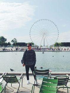 dinhuwilliams in Paris wearing a H&M military hoodie