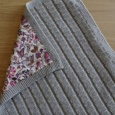 "Yummy Liberty Tana Lawn fabric on the back on this knitted baby blanket. Love it! Ravelry: FeebyB's ""Maxi Cosi"" blanket"