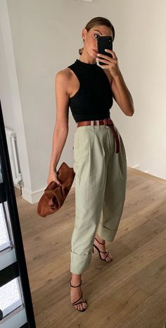 I love the looseness of the pants with the tight black tank top. And i love how simple the whole look feels. Trend Fashion, Estilo Fashion, Look Fashion, Womens Fashion, 70s Fashion, Korean Fashion, Japanese Fashion, Fashion 2020, Girl Fashion