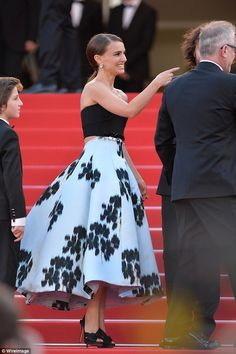 Style star: Adding height to her look with black peep-toe heels, the mother-of-one was glo...