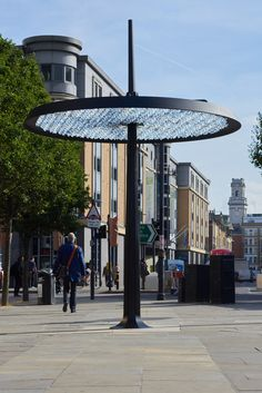 ommatidium is a piece of street art, a lamp, a meeting place, a maker of rainbows and the gateway to a vast digital resource for anyone passing under it.