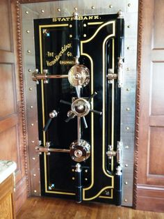 gold leafing Vault door, hand painted pinstriping. Gold leafed letters & striping. Victor safe & lock company.