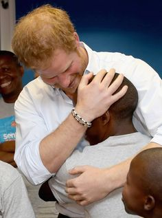 Prince Harry greets his old friend 16 year-old Relebohile 'Mutsu' Potsane ( who Prince Harry has stayed in touch with since they first met during his first visit to Lesotho in 2004) who is singing as part of the Basotho Youth Choir, at the Brit School on June 27, 2016 in London, England.