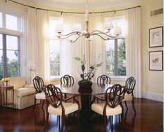 Lovely Dining Room Design with Beautiful Lighting.  Charles Fradin designed Geller Dining Chairs