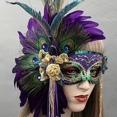 La JolieMardi GrasMasquerade Mask - Gorgeous look for Fat Tuesday - mask by Gypsy Renaissance. Purple and peacock feathers, gold rose, green swords. French Quarter New Orleans.
