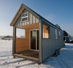 Tiny Houses On Wheels | Tiny house on wheels with covered porch.