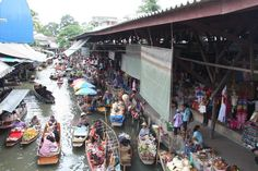 in the central floating market at Domnoen Saduak floating market in Thailand, Activity to do here you have to go on paddle boat and explore it.