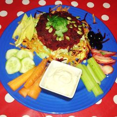 Beet and Bean Burger served on a mountain of lettuce and grated carrot with avacado veggie sticks sliced apple olives and hummus topped with coriander pumpkin and sunflower seeds #veganuary #veganuary2017 #govegan #eatrealfood #eatclean #nutrition #plantbased #wardymoo #bearsteps #schooloflife
