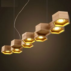 suspension bois design par Pilke Light en forme nid d'abeilles à 9 alvéoles…