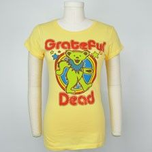 This awesome Grateful Dead shirt is a perfect way to show some retro love for the 'Heart of Gold Band'! With a cool 70's look in cheerful colors, this Grateful Dead dancing bear tee looks great on every gal!  $20.00