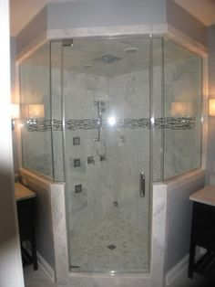 Steam Shower with 4 panel shower rainhead and body jets, carrera marble traditional bathroom