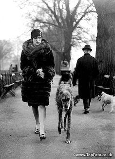 Mrs Worthington walks her Irish Wolfhound in the park, London  9th February 1928