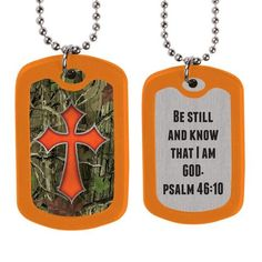 "Camo Cross Dog Tags Psalm 46:10 says, ""Be still and know that I am God."" So, when the busyness and noise of life pushes you from all sides just look down at this Christian dog tag and be reminded that you can slow down and talk with the Creator of the universe. Each Kerusso dog tag is surrounded by heavy rubber edging and suspended from a 24-inch ball chain."