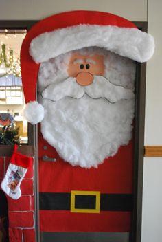 Teachers can create a Santa classroom door display using construction paper and cotton balls.