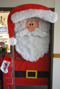 Teachers can create a Santa classroom door display using construction paper and cotton balls.
