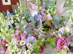 Wedding bouquets of English cottage garden country flowers in preparation for a summer wedding.  Honey Pot Flowers of Warwick