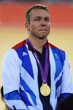 Gold medallist Sir Chris Hoy of Great Britain cries as he celebrates during the medal ceremony for the Men's Keirin Track Cycling Final on Day 11 of the London 2012 Olympic Games at Velodrome on August 7, 2012 in London, England.