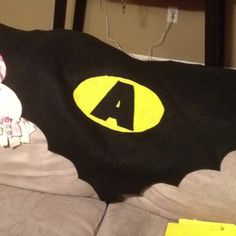 A batman birthday cape with kids initial on it, I made this for my step son for his Batman birthday party on Sunday
