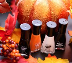 Sally Hansen Insta-Dri Fast Dry Nail Colors from the left: Night Fright, Pumpkin Queen, OMGhost and Scaredy Matte, $5 each