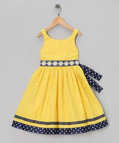 As bright as a daisy, this dress features eyelet fabric and a contrasting tie. Stretchy straps and a zipper mean this piece is ready to join the party in a playful yet pretty fashion.