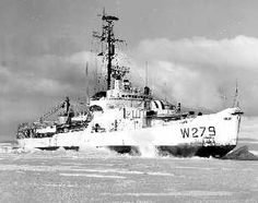 """OPERATION DEEP FREEZE -- 1963.  The 269-ft., 6,515 ton U.S. Coast Guard icebreaker EASTWIND rips open a channel through frozen McMurdo Sound for cargo ships carrying personnel, equipment, and supplies for scientific stations in the [sic] Antarctica.  In some areas the ice is 10 to 20 feet thick.""    Photo No. 6082; date/photographer unknown.    The Eastwind became the first cutter to ever circumnavigate the globe."