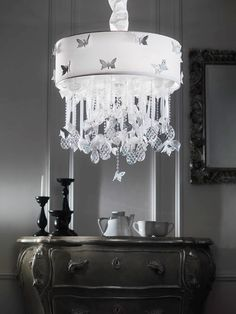 Lulù-C Polished butterflies with Swarovski® embedded Strass suspended by organza  tapes pearls and small glass transparent chains.  Cone shade with organza small roses